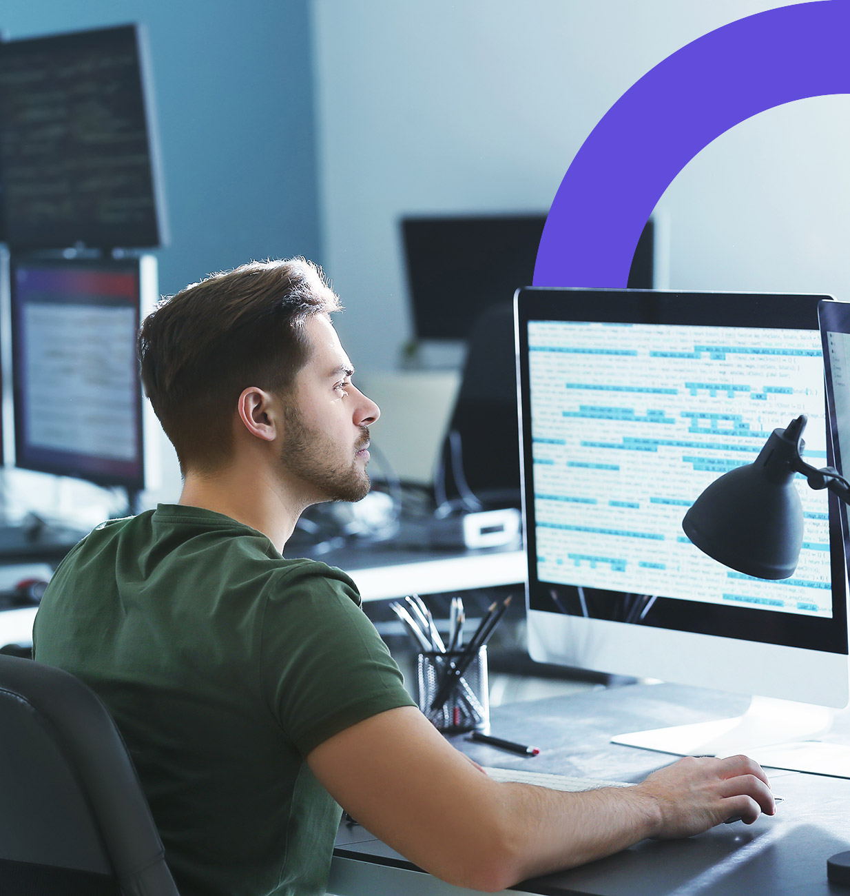 Developer working on code in front of a monitor.